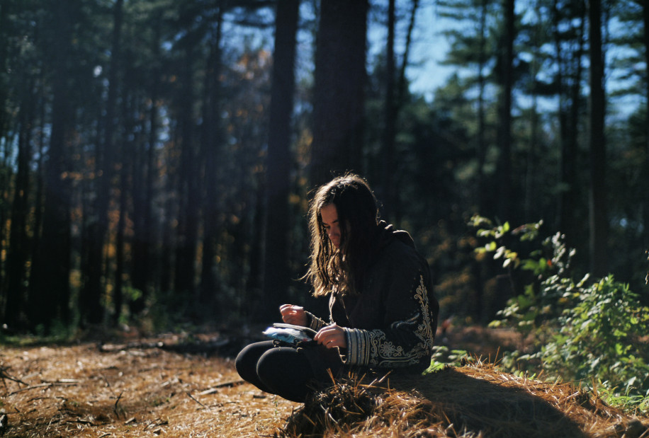 Teenager Journaling in Forest